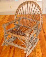 This unusual rocking chair is made of rough wood to give it an old-fashioned look.