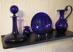Metallic additives in the glass mix can produce a variety of colours. Here cobalt has been added to produce a bluish coloured decorative glass.