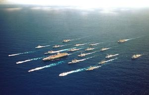The USS Abraham Lincoln Battle Group along with ships from Australia, Chile, Japan, Canada, and Korea speed towards Honolulu in RIMPAC 2000.