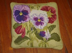 A tapestry cushion, depicting pansies